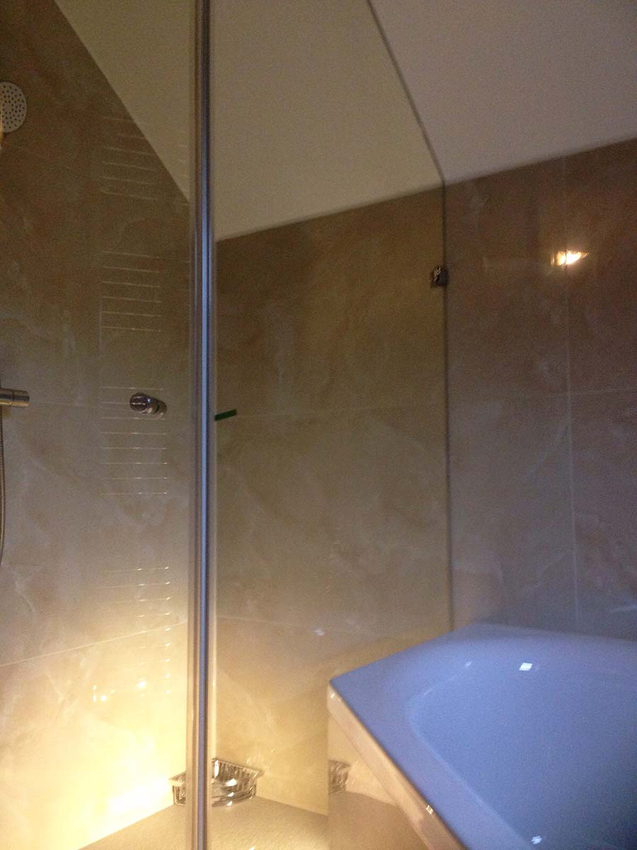 This frameless glass shower has been custom made by Room H2o for a loft conversion in Kilburn