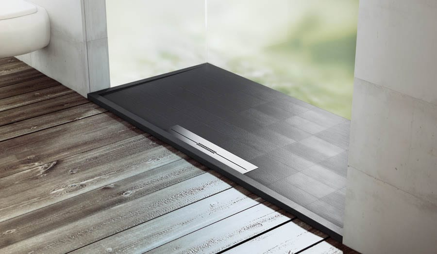 A Fiora Silex low profile shower tray with tile finish and linear stainless drain