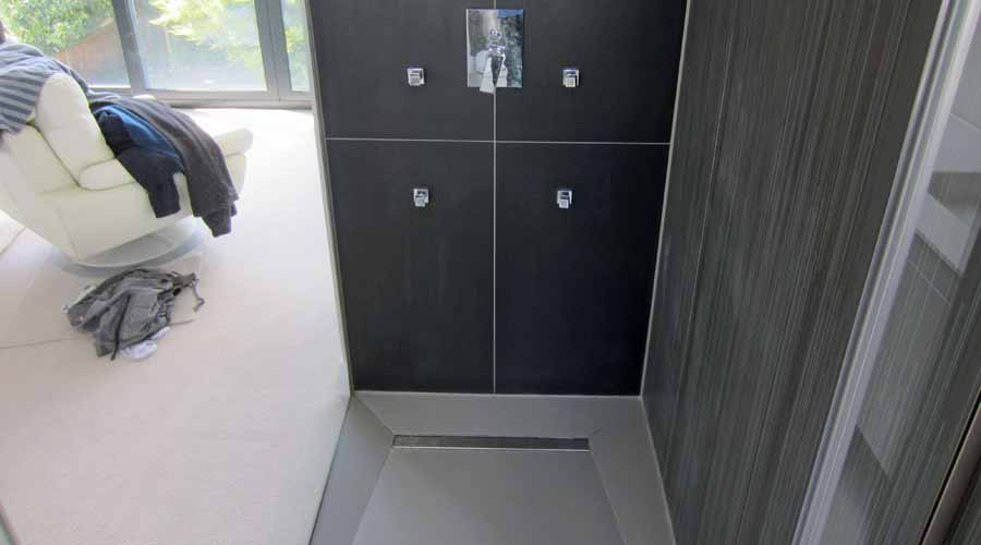 Black Mono Porcel Thin tiles with contrasting Zebrano print tiles in a wet room
