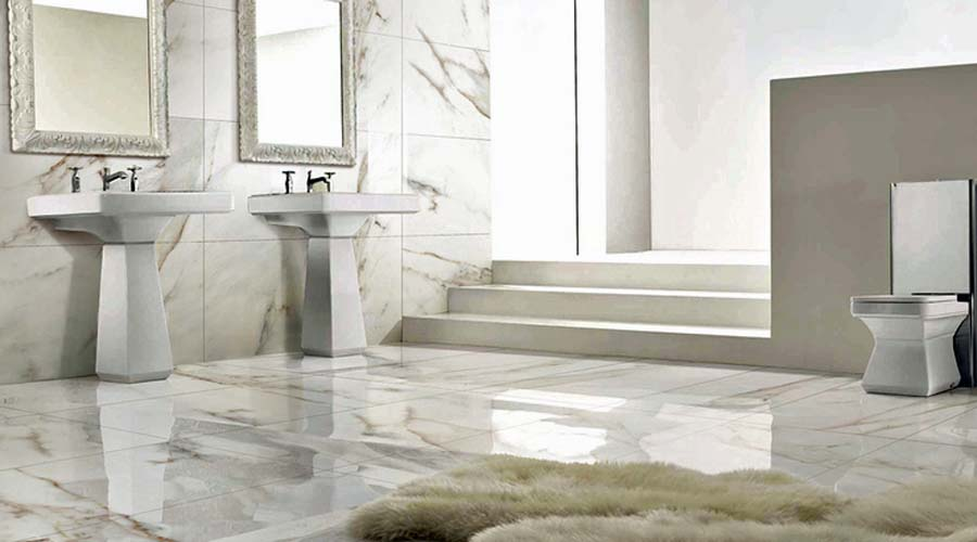 Porcel Thin White Carrara marble printed large format ultra thin floor and wall tiles in a large bathroom