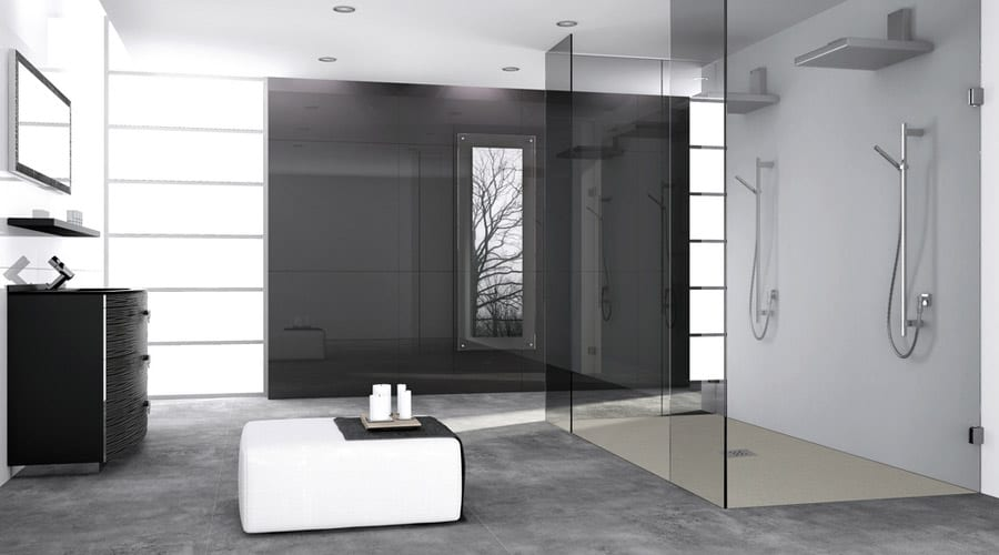 A large luxurious frameless glass shower walk in shower enclosure with twin shower heads and Fiora Elax wet floor shower tray