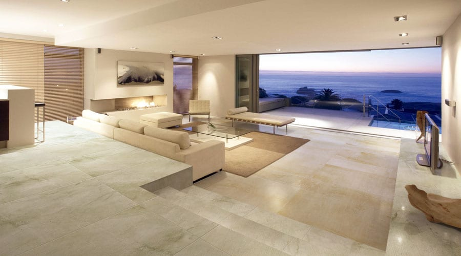 A Large luxury lounge tiled with Porcel-Thin large format 1200 x 600mm Sandstone effect ultra-thin porcelain tiles