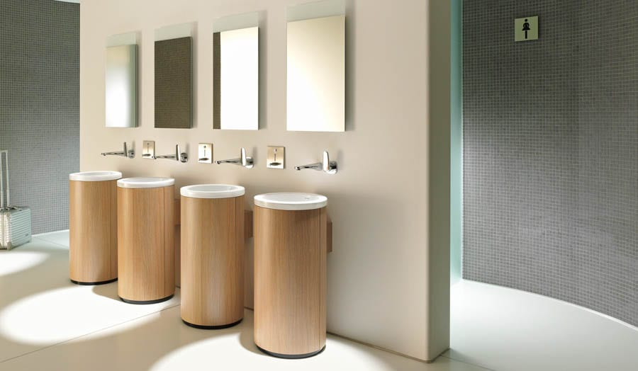 A design for a luxury hotel washroom featuring Duravit ONTO contemporary freestanding wash basins