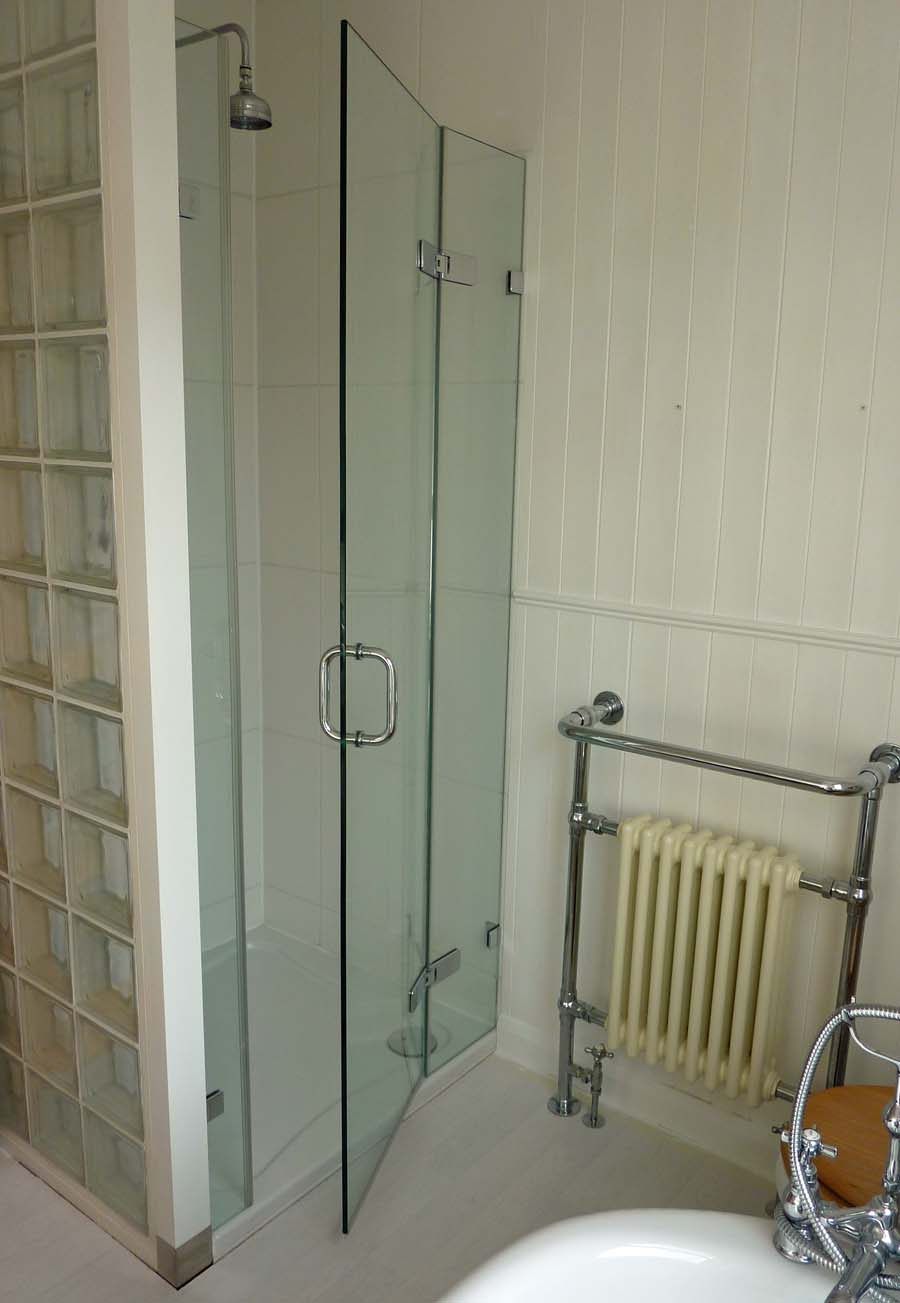 Room H2O 10mm glass frameless shower door between 2 fixed glass inline panels