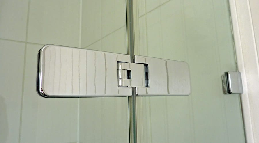 Frameless shower doors feature high quality adjustable hinges that hold the door shut and require only minimal clear seals for a truly minimalist appearance