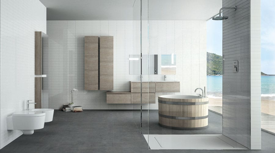 A large frameless glass walkin shower with round bath and Adatto Casa wooden contemporary bathroom furniture