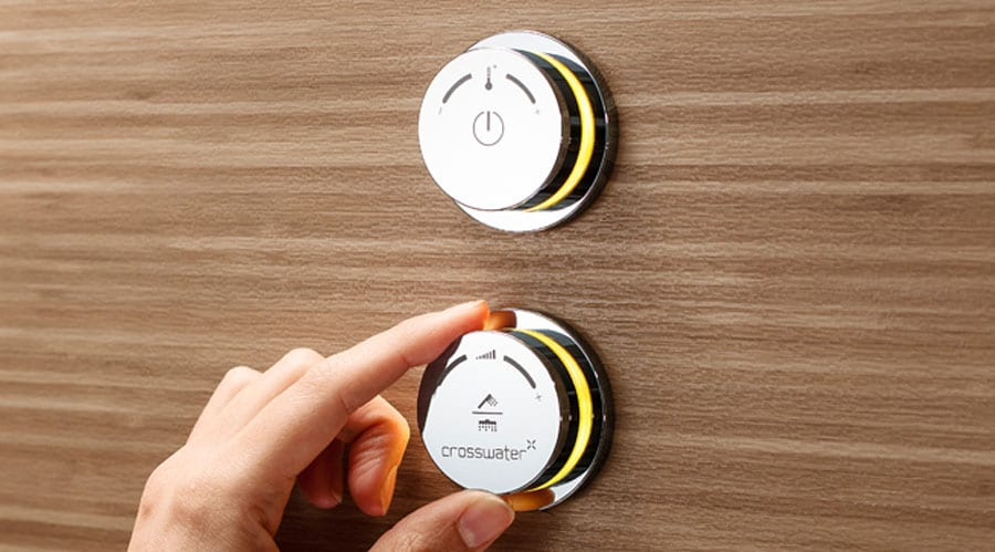 Crosswater Digital DUO provides remote control of water temperature and flow and allows switching between a bath filler or shower head and hand shower