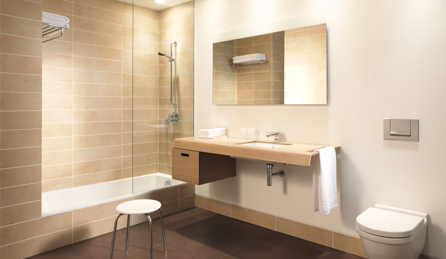 Duravit Onto hotel bathroom with sunken bath and walk in shower screen