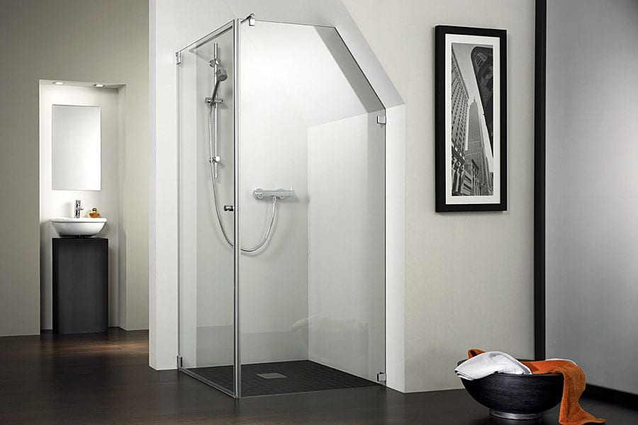 A made to measure sem-frameless shower enclosure with angled side panel to suit a loft conversion by Room H2o