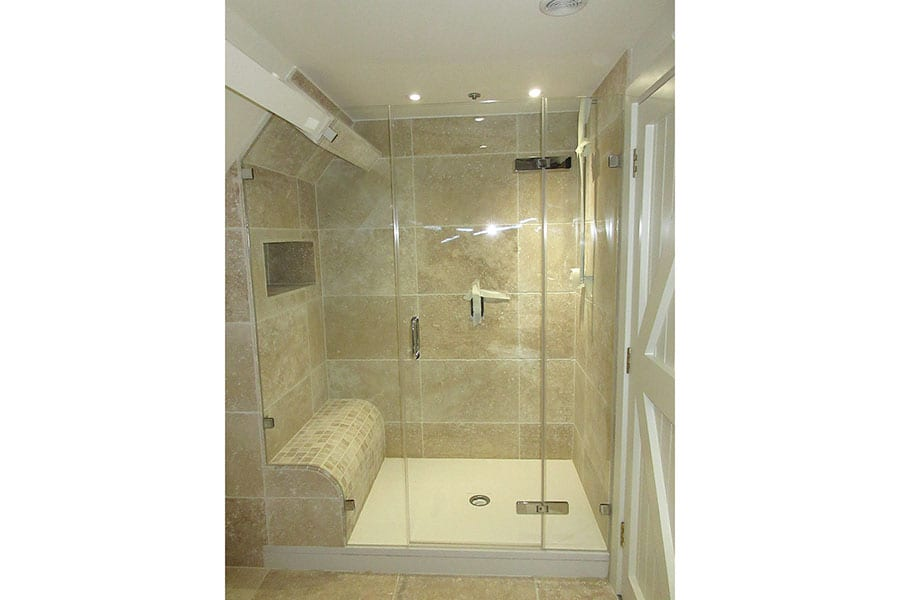 Bespoke glass shower with tray and tiled shower seat by Room H2o