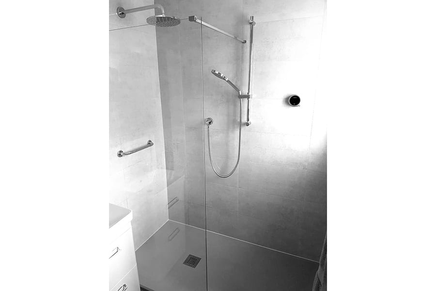 Disability shower room with grab bars