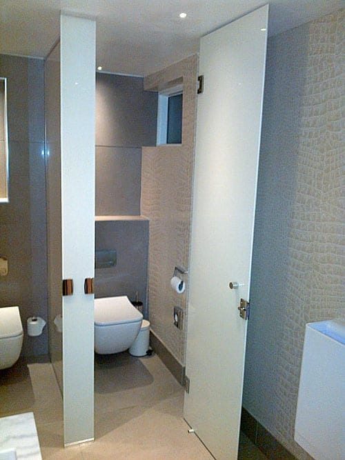 Floor to ceiling white painted glass toilet cubicles manufactured by Room H2o for the Dog & Badger