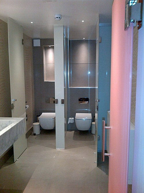 Colourful painted glass washroom entrance door and toilet cubicles by Room H2o for the Dog & Badger Marlow