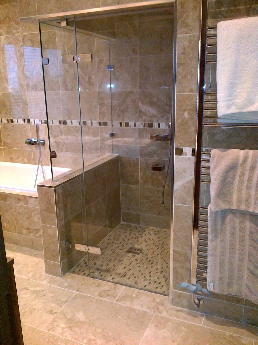 Smoked glass bespoke frameless shower enclosure