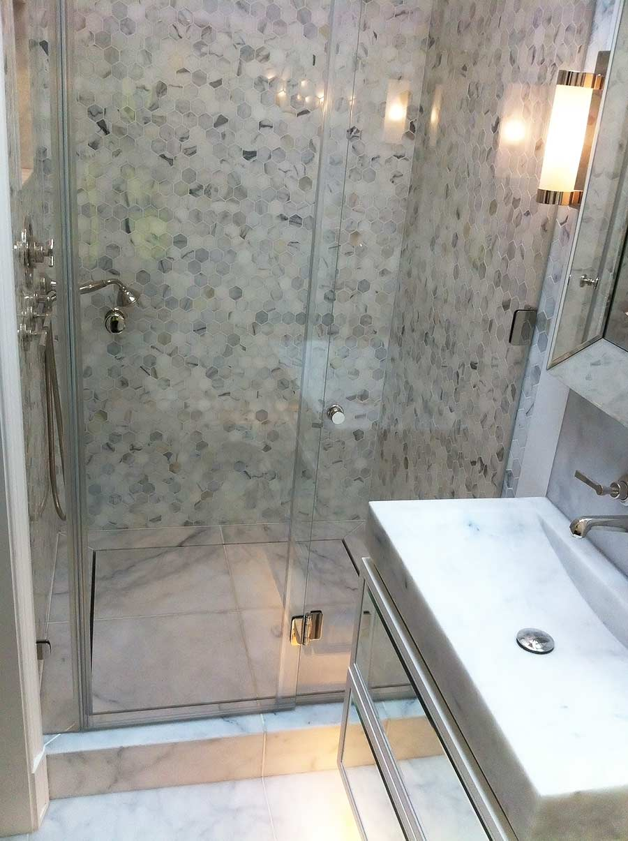 Frameless glass bifolding hinged shower door by Room H2o