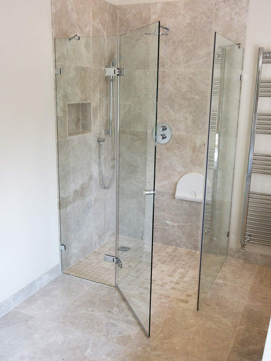 Frameless bespoke shower enclosure with inline panel in modern bathroom
