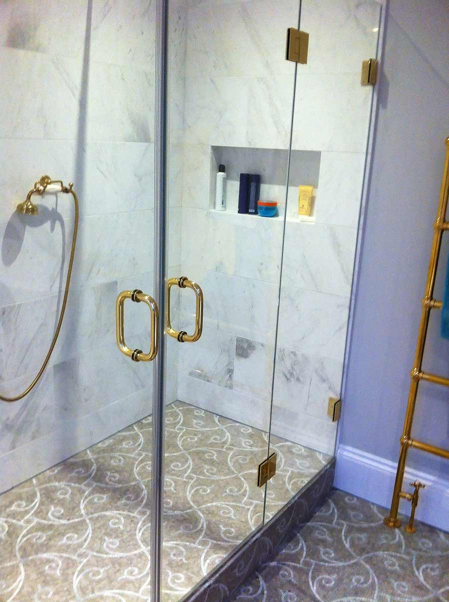 Large double door inline frameless shower enclosure with fittings in antique gold to match made and installed by Room H2o