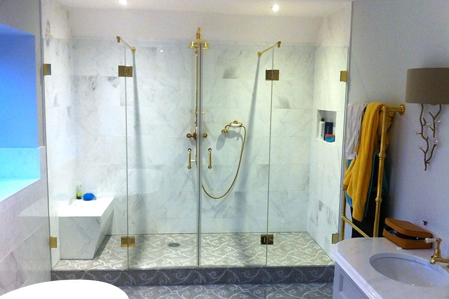 The components of this large frameless shower were colour matched to the antique gold brass ware in this bathroom