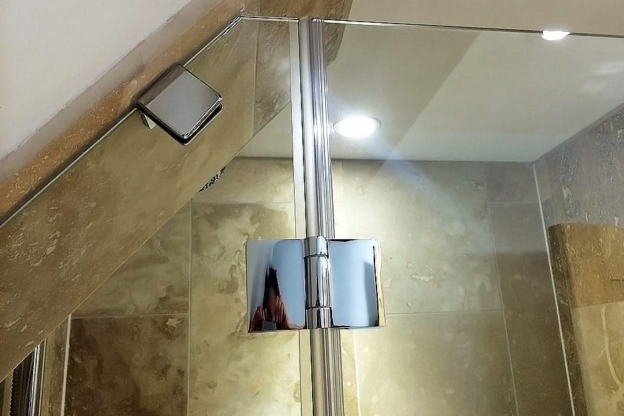Angled detail of a semi-frameless shower door made by Room H2o