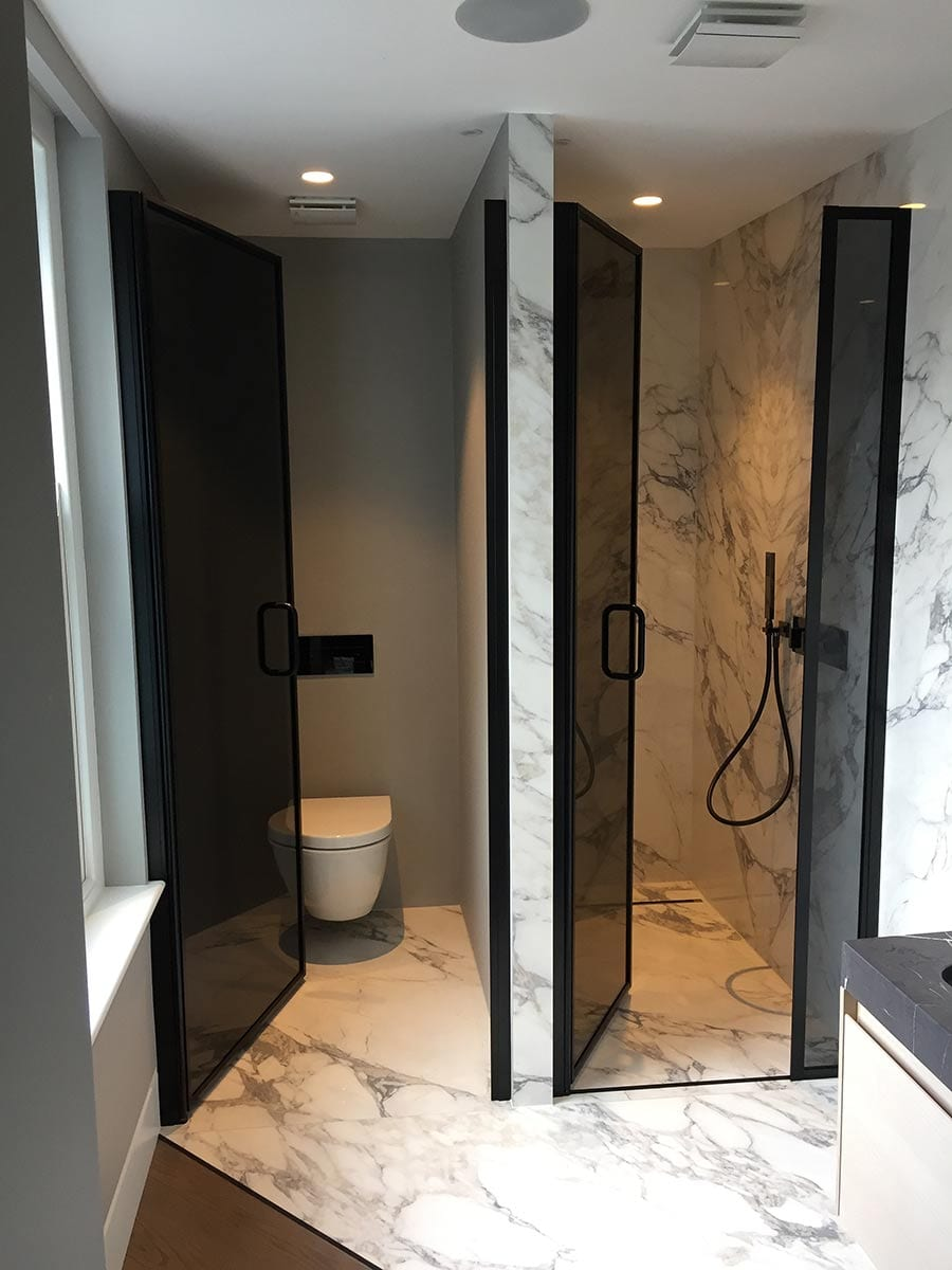 Black glass bespoke shower and toilet doors made by Room H2o