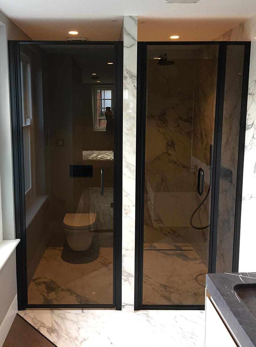 Bespoke toilet and shower doors in black glass with black frame and fittings by Room H2o