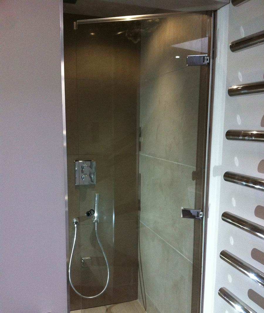 Semi-framed inward opening made to measure hinged shower do by Room H2o