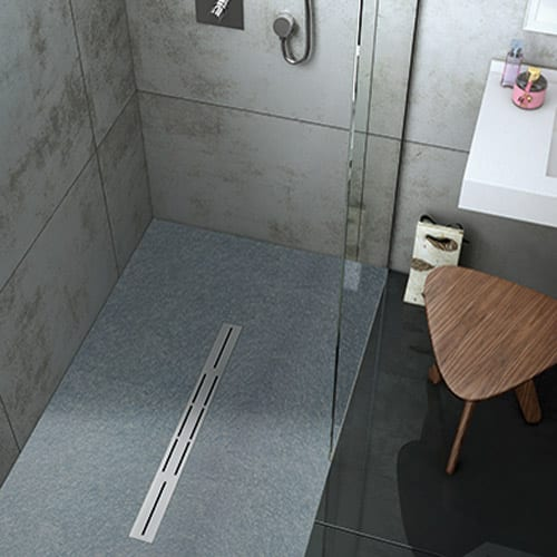 A luxury walk-in shower featuring a Fiora Privilege wetroom shower tray in Nature Cenere colour with linear waste