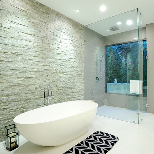 Luxury bathroom with free standing bath and frameless glass shower