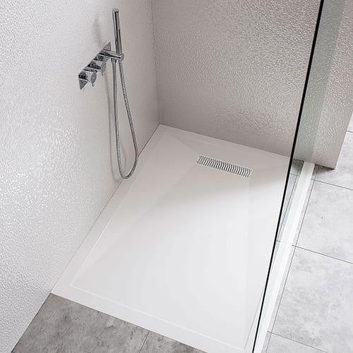 Designer 25mm low profile shower tray with linear stainless waste by Simpsons